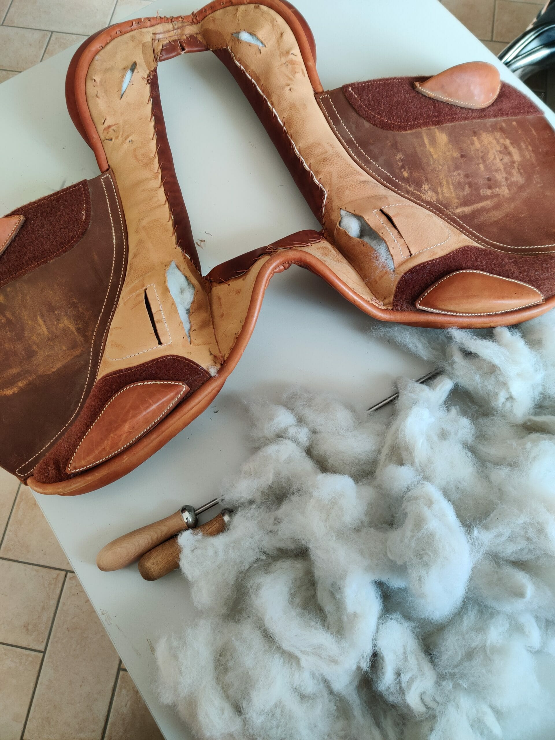 Ilaria saddle service - saddle fitting - reimbottitura cuscini